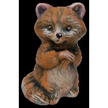 Ceramic raccoon figure