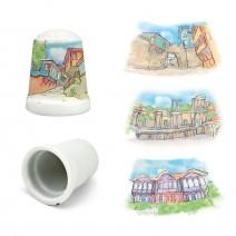Porcelain souvenir thimble with different resorts