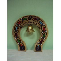 Wooden horseshoe pyrography with a bell